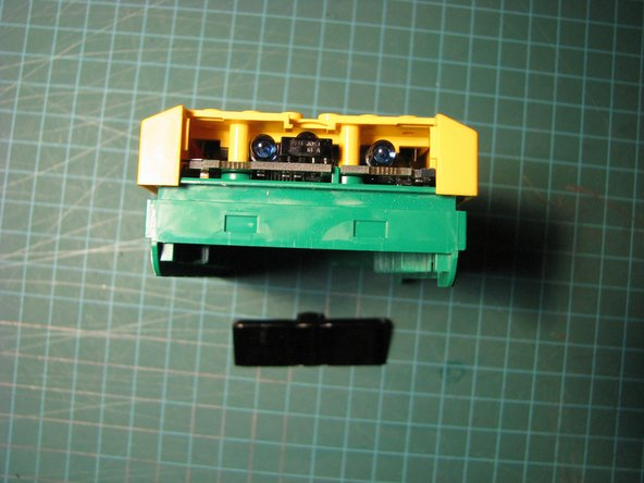 Image 1/2: Make sure the case doesn't get stuck on the power connector on the back of the RCX.