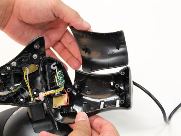 Remove exterior panel from the throttle by using your hands to gently pull the panel away.