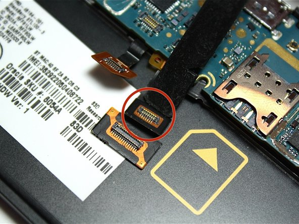 Repeat the same step for the final ribbon cable located under the larger one.