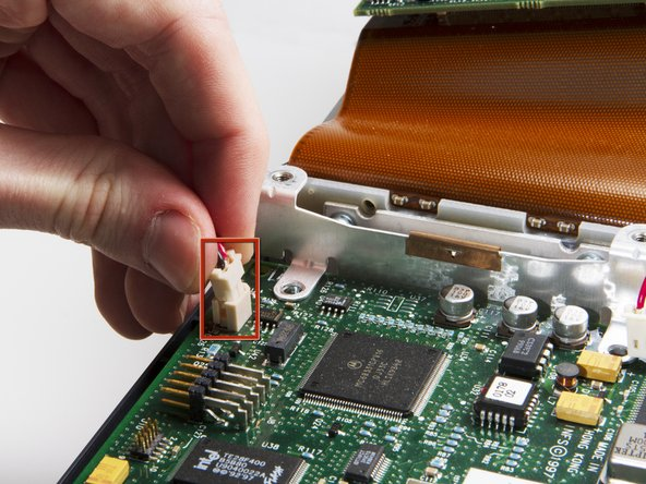 Flip up the DLP board, leaving it attached to the large ribbon cable.