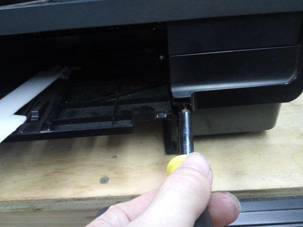 Remove the single silver screw (pictured)