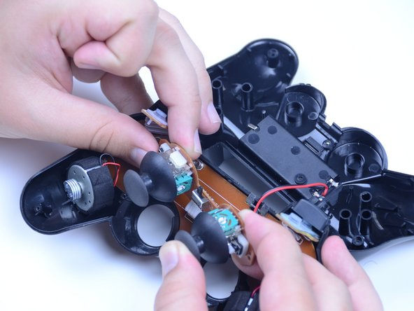 Realign the analog stick by pushing the removed stick back into its chassis with focus on pushing it in at the new, desired resting angle. You should feel or hear a small click if done correctly.