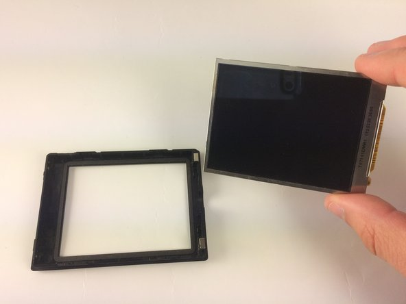 Use your fingers to remove the LCD screen from its encasing. It comes out very easily.