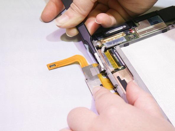 There is adhesive attached to the back of the larger chip on the touchscreen controller strip.