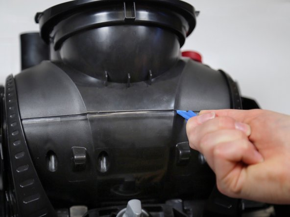 Flip the vacuum so that it is right side up again  with the front of the motor cover facing you.