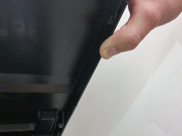 Slide the plate towards the back of the printer until the latches are released.