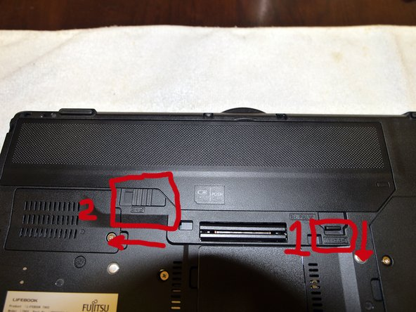Remove battery by pushing down the latch lock and sliding the latch to the left as shown.