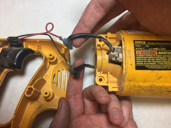 Remove the red and black trigger wires from the brush leads with the pliers.
