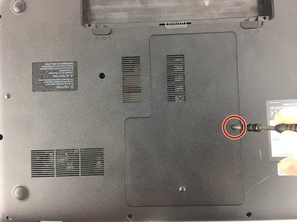 Remove the 7mm screw near the center of the  back of the laptop with a P1 screwdriver  and pry off the access panel with a nylon spudger.