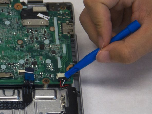 Pull down gently on the black speaker cable connector to disconnect it from the motherboard.