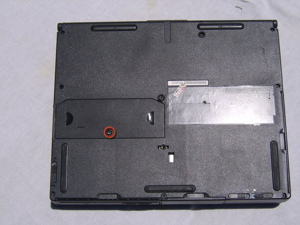 Locate RAM access panel located on the bottom of the Compaq Armada.