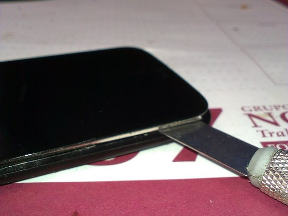 With a Metal thin blade, insert between bezel and LCD, and bend it to start releasing.