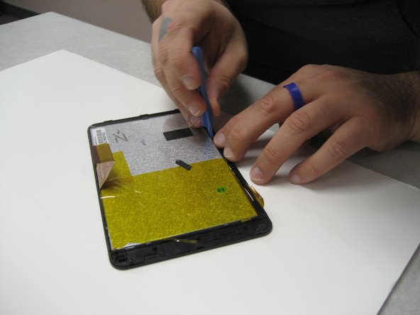 To remove the LCD from the screen casing, gently pry it out of the clips that are holding it in place.