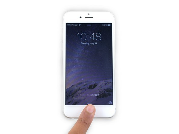 Image 1/2: While holding the Home button, press and hold the Sleep/Wake button.