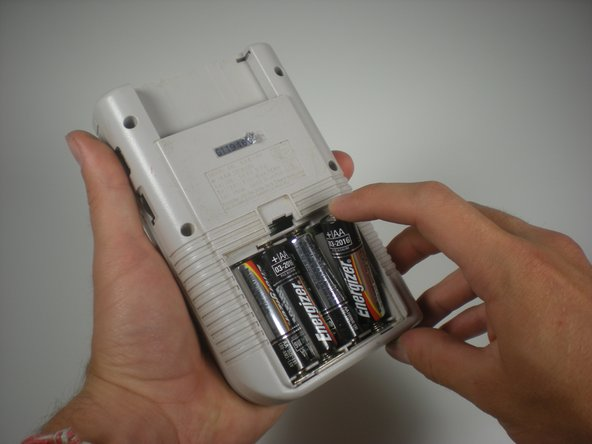 Now put the batteries back into the compartment, so you can test the screen while you fix it.