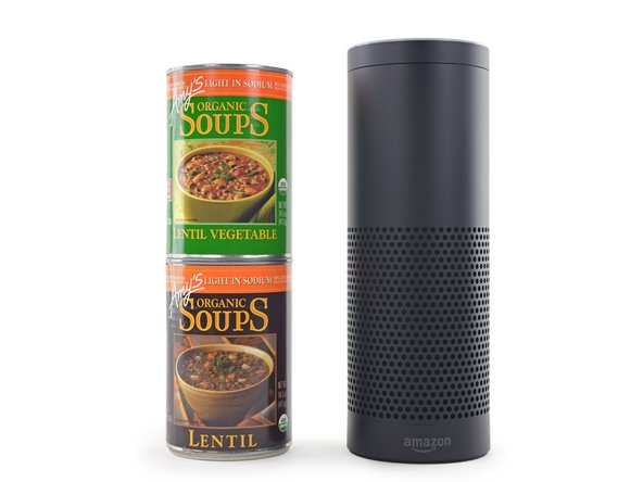 The Amazon Echo standing just taller than two cans of soup
