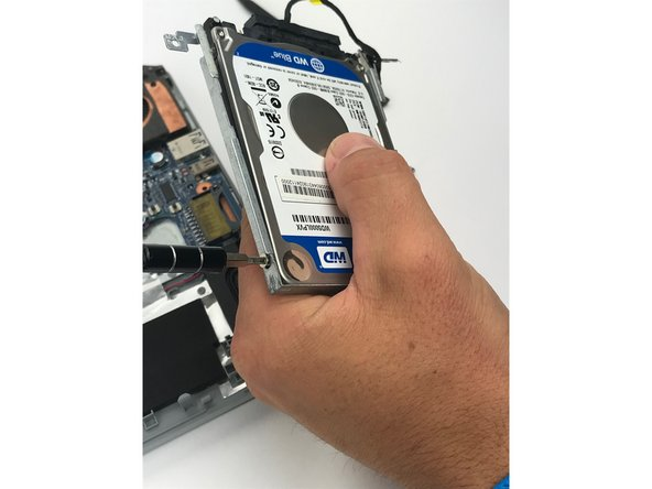 Separate the hard drive from the mounting rail.