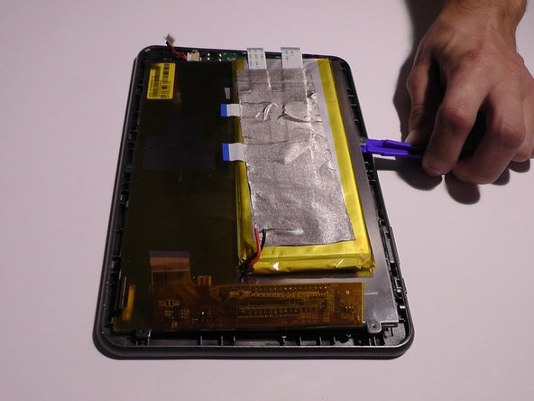 Using the plastic removal tool, lift the LED screen from the battery side, and use the tweezers to help lift the LED screen upwards.