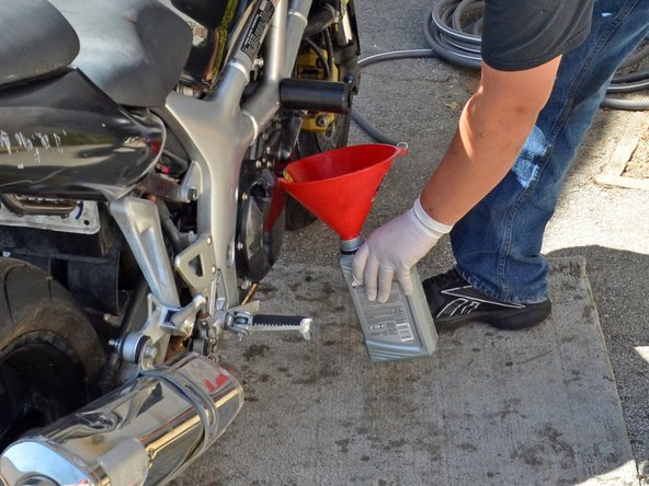 When draining has slowed to a drip, stand the bike up vertically to allow the last of the coolant to drain.