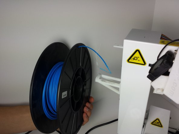 Remove the spool from the spool holder by lifting it up and taking it off.