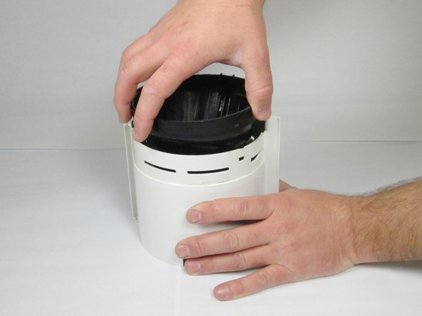 Once the filter basket has been pried loose, grab the filter basket and lift it out of the housing.