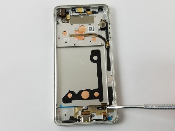 Gently pry the USB-c port assembly out of the frame.