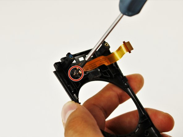 Use the T5 Torx head screwdriver to remove the two silver 4.2mm screws from the rear plastic cover of the menu button.