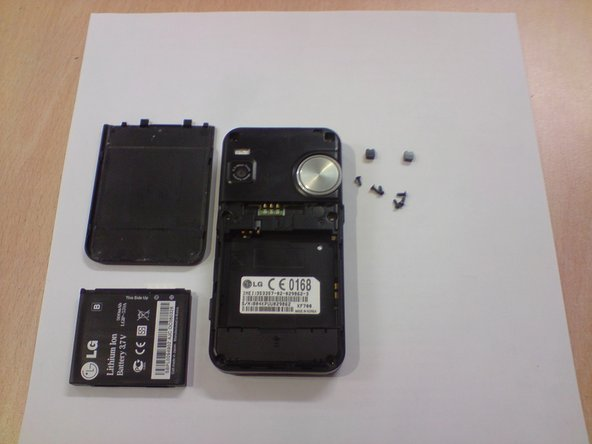 Two screws found under the plastic clips removed as well as another four screws found around the battery.