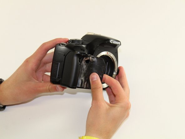 Remove front grip by gently peeling from the edge towards the center of the camera