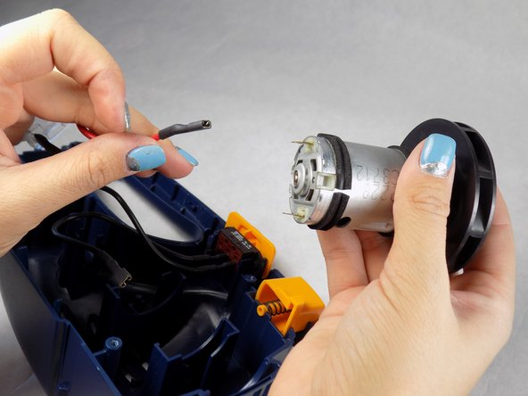 Pull your motor out, and remove the black and red cables from the motor by hand.