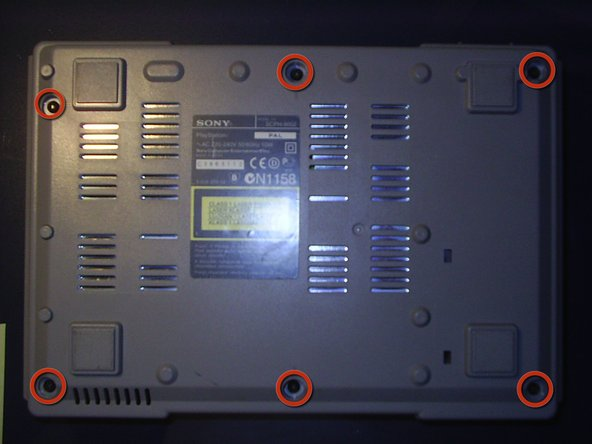 Turn the PS1 over and remove the six screws.