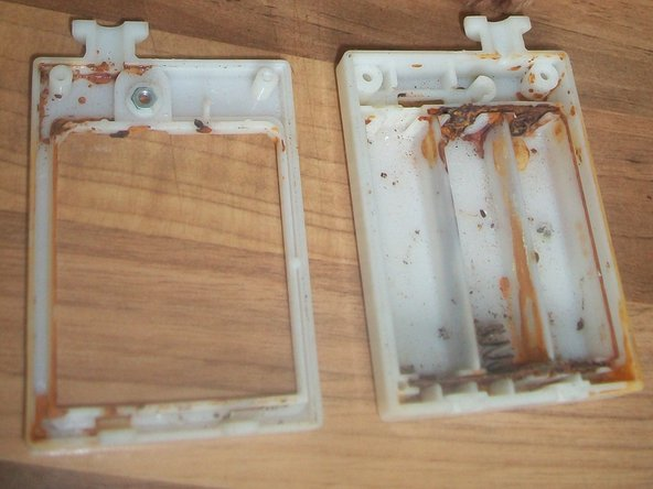 All that is left of a 3xAA battery pack and switch following the removal of corroded batteries.