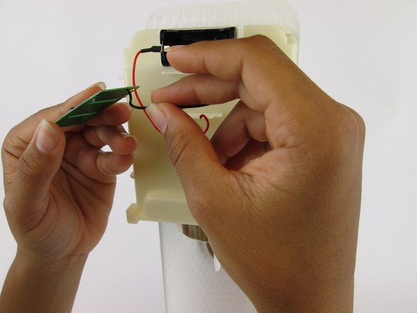 Image 2/3: While reconnecting the wires, you will need a hot glue gun to reattach the wire ends to the new chip.