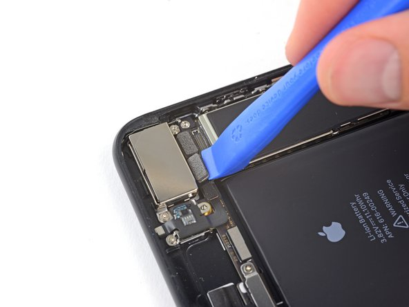 Use an iFixit opening tool or a fingernail to disconnect the two camera cable connectors by prying them straight up from their sockets.
