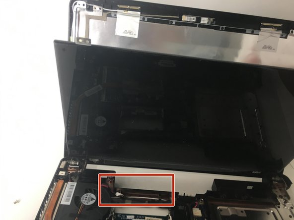 Pop out the connector that links the screen to the motherboard.