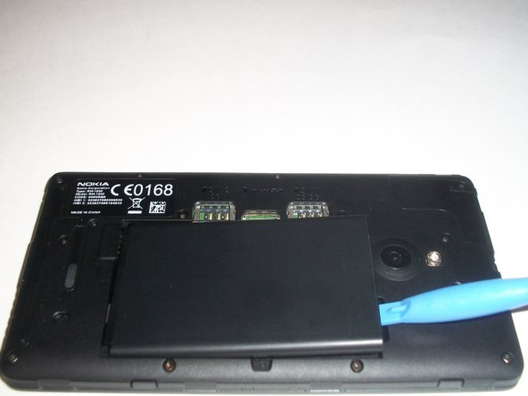 Again, use the plastic opening tool to lift the battery. From there, you can simply remove it.