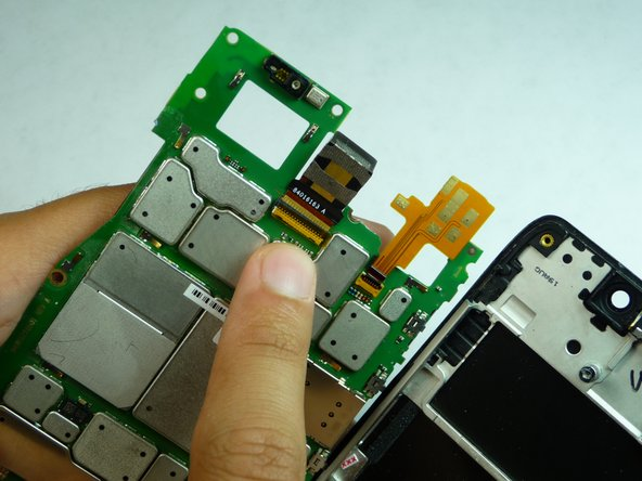 When the tape is out and the camera connectors disconnected use a plastic opening tool to lift up the tab on the rear-facing camera