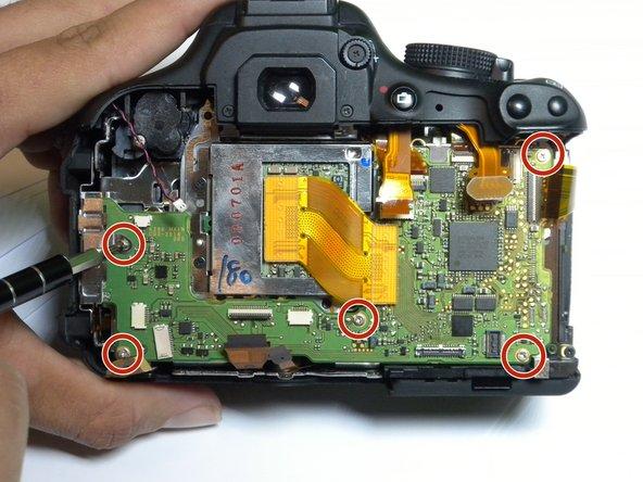 Remove the five 4 mm Phillips #000 screws.