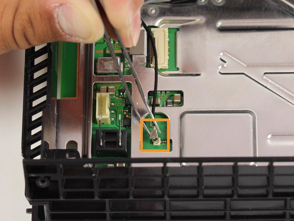 Remove the wifi antenna cable attached to the motherboard.