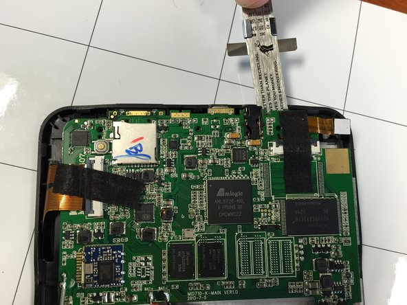 Image 2/3: DO NOT try to separate the inner screen from the motherboard in this step.