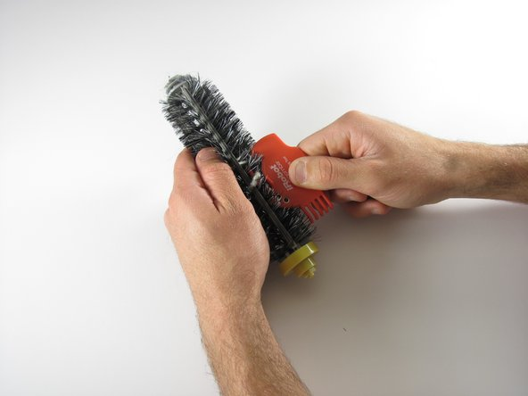 Slide the brush cleaner down and back up until your brush is clean