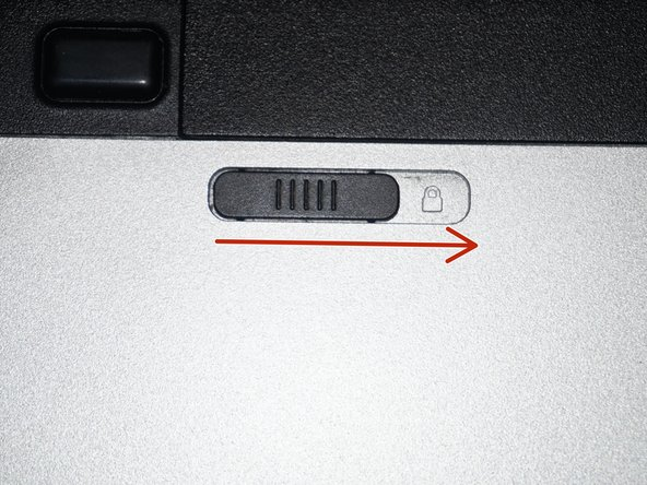 Once the computer is off, remove the battery. Pull the locking tab to the unlocked position.