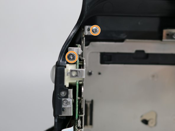 Remove the two 4.3 mm screws above the LED securing the microphone housing to the frame.