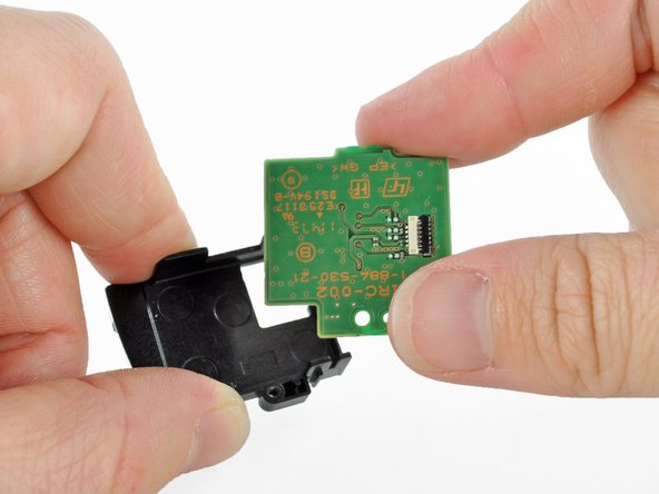 Separate the SIM card reader from the SIM card reader retainer.