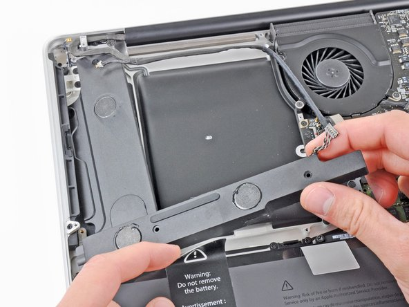 Image 1/1: Hold the battery sticker out of the way as you remove the subwoofer & right speaker from the upper case.