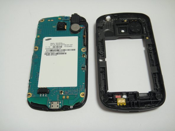 Image 3/3: Carefully disconnect ribbon cables and slowly lift the inside back cover to remove it.