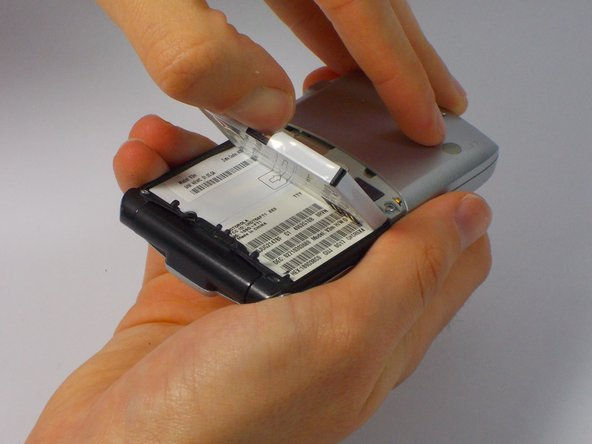 Push the top edge of the battery and lift away from the phone.