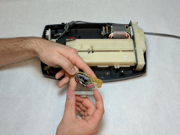 Image 1/2: After the plastic case is removed, the switch can be replaced.