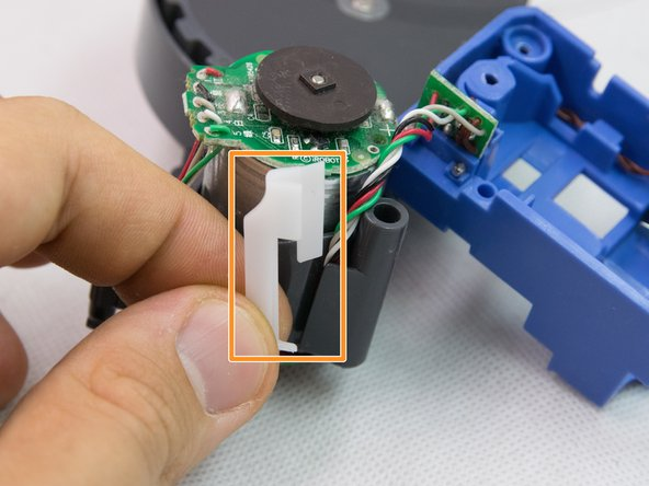 Remove the plastic stopper that keeps the motor wires in place