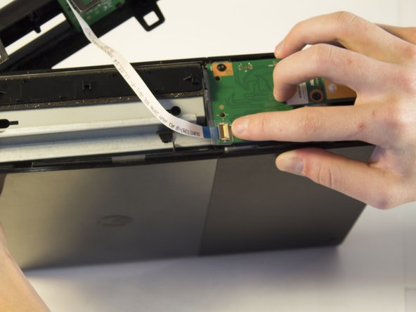 Do no pull off the panel too fast because you don't want to damage the ribbon cable. Slowly pull away the panel.